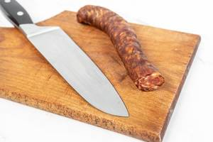 Domestic Homemade pork meat Sausage with knife on the cutting board (Flip 2019)