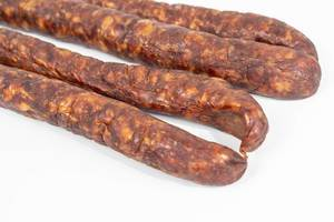 Domestic Homemade pork meat Sausages above white background (Flip 2019)