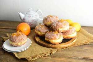 Donuts with icing and candied orange peel