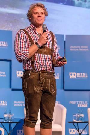 Dr. Julian Hosp - President of TenX holding a speech at the Bits & Pretzels 2018