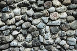 Dramatischer Steinhintergrund – Nahaufnahme einer Wand aus Steinen