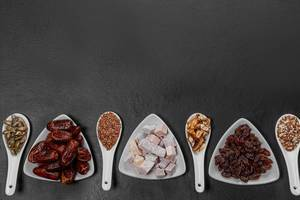 Dried fruits, nuts and seeds on a black background with free space. Healthy food concept (Flip 2019)