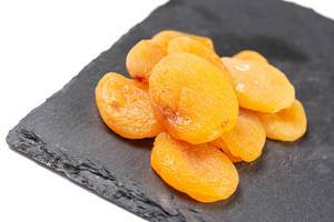 Dried Peaches on the black stone tray
