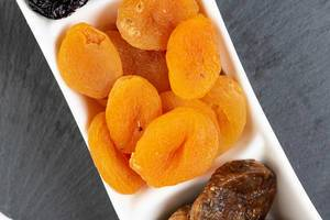 Dried Peaches served on the plate (Flip 2019)