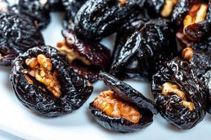 Dried prunes stuffed with walnuts