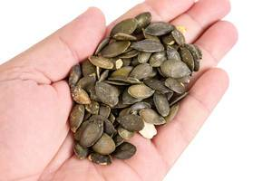 Dried saulty Pumpkin Seeds in the hand