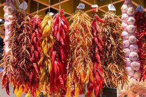 Dried spices such as chilli and garlic, displayed at the Mercat de la Boqueria market at the La Rambla promenade in Barcelona