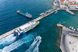 Drone picture of a ferry in the Argolic Gulf, which brings tourists to Prokymaia on Spetses, Greece