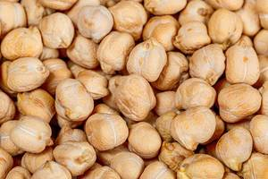 Dry raw chickpeas background. Top view