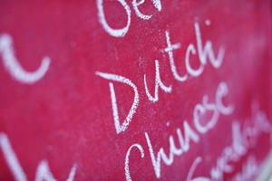 Dutch, among many foreign languages written with chalk, school chalkboard