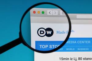 DW logo under magnifying glass