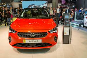 E-Mobilty by Opel: front view of red Corsa-e, electric car with keyless start and automatic climate control