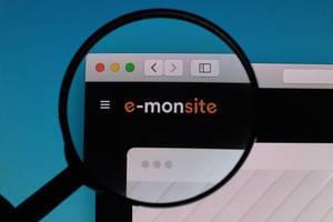 E-monsite logo under magnifying glass