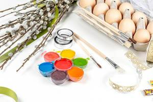 Easter-background-with-eggs-paints-brushes-and-willow-branches.jpg