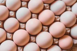 Eggs background.  Chicken eggs in carton (Flip 2020)
