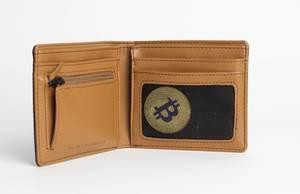 Ein Bitcoin in einem Portemonnaie