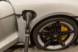 Electric car charging with CCS plug on Porsche Taycan Turbo S e-sports car
