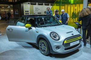 Electric car Mini Cooper SE in grey-yellow, with type 2 and CCS Combo 2 plug for charging
