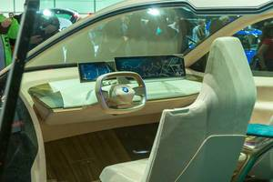 Electro mobility and designer drivers seat and simple interior of the futuristic electric car BMW Vision iNext