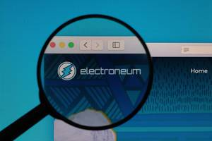 Electroneum logo under magnifying glass