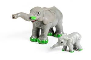 Elephant and baby elephant figures on a white background