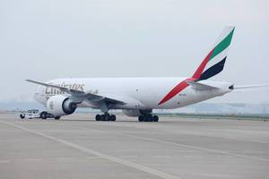 Emirates SkyCargo plane baing towed