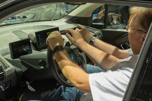 Emission-free driving: Men sitting in the electric car BMW i3, for carsharing service DriveNow