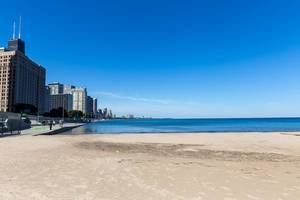 Empty Ohio Street Beach on the shores of Lake Michigan in Chicago on a sunny autumn day with blue sky