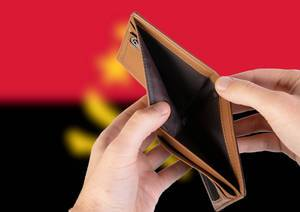 Empty Wallet with Flag of Angola. Recession and Financial Crisis to come with more debt and federal budget deficit?