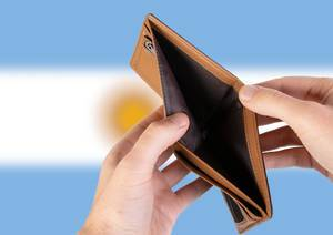Empty Wallet with Flag of Argentina. Recession and Financial Crisis to come with more debt and federal budget deficit?