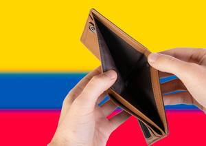 Empty Wallet with Flag of Colombia. Recession and Financial Crisis to come with more debt and federal budget deficit?