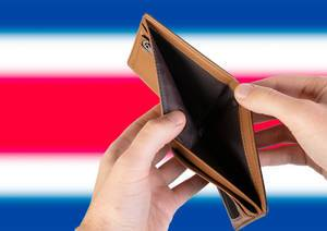 Empty Wallet with Flag of Costa Rica. Recession and Financial Crisis to come with more debt and federal budget deficit?