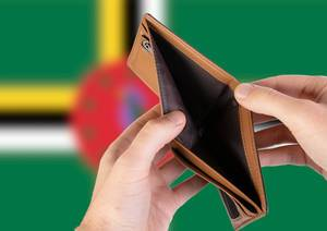 Empty Wallet with Flag of Dominica. Recession and Financial Crisis to come with more debt and federal budget deficit?
