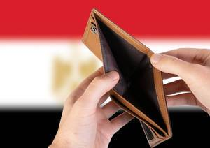 Empty Wallet with Flag of Egypt. Recession and Financial Crisis to come with more debt and federal budget deficit?