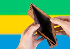 Empty Wallet with Flag of Gabon. Recession and Financial Crisis to come with more debt and federal budget deficit?