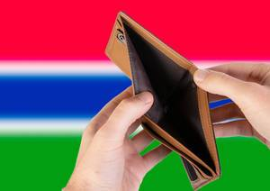 Empty Wallet with Flag of Gambia. Recession and Financial Crisis to come with more debt and federal budget deficit?