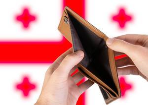 Empty Wallet with Flag of Georgia. Recession and Financial Crisis to come with more debt and federal budget deficit?