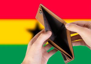 Empty Wallet with Flag of Ghana. Recession and Financial Crisis to come with more debt and federal budget deficit?