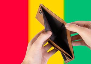 Empty Wallet with Flag of Guinea. Recession and Financial Crisis to come with more debt and federal budget deficit?