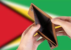 Empty Wallet with Flag of Guyana. Recession and Financial Crisis to come with more debt and federal budget deficit?