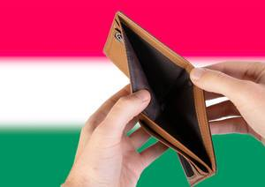 Empty Wallet with Flag of Hungary. Recession and Financial Crisis to come with more debt and federal budget deficit?