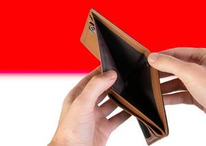 Empty Wallet with Flag of Indonesia. Recession and Financial Crisis to come with more debt and federal budget deficit?