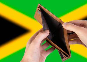 Empty Wallet with Flag of Jamaica. Recession and Financial Crisis to come with more debt and federal budget deficit?