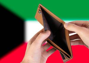 Empty Wallet with Flag of Kuwait. Recession and Financial Crisis to come with more debt and federal budget deficit?