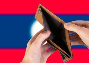 Empty Wallet with Flag of Laos. Recession and Financial Crisis to come with more debt and federal budget deficit?