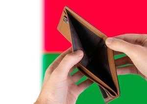 Empty Wallet with Flag of Madagascar. Recession and Financial Crisis to come with more debt and federal budget deficit?