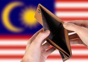 Empty Wallet with Flag of Malaysia. Recession and Financial Crisis to come with more debt and federal budget deficit?