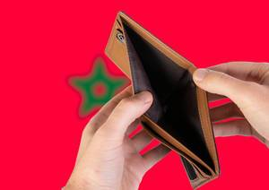 Empty Wallet with Flag of Morocco. Recession and Financial Crisis to come with more debt and federal budget deficit?