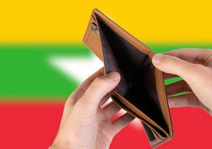 Empty Wallet with Flag of Myanmar. Recession and Financial Crisis to come with more debt and federal budget deficit?
