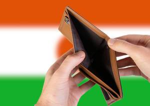 Empty Wallet with Flag of Niger. Recession and Financial Crisis to come with more debt and federal budget deficit?